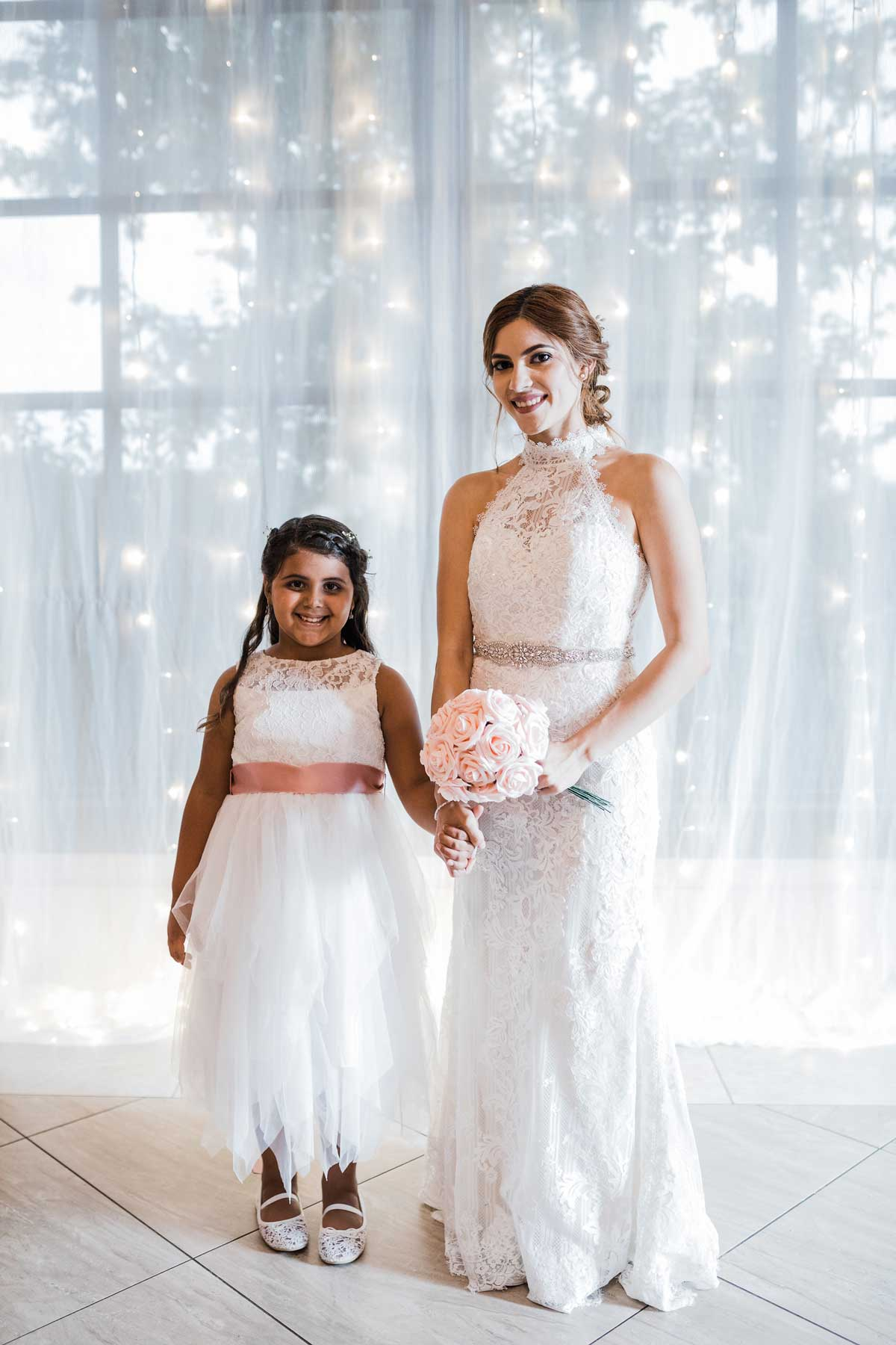 photo of the bride and flower girl