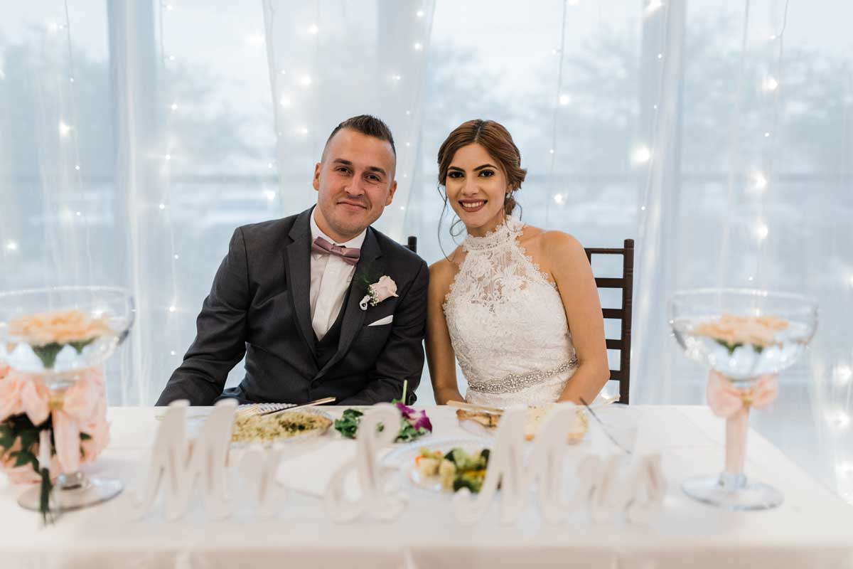 photo of bride and groom seated at designed table
