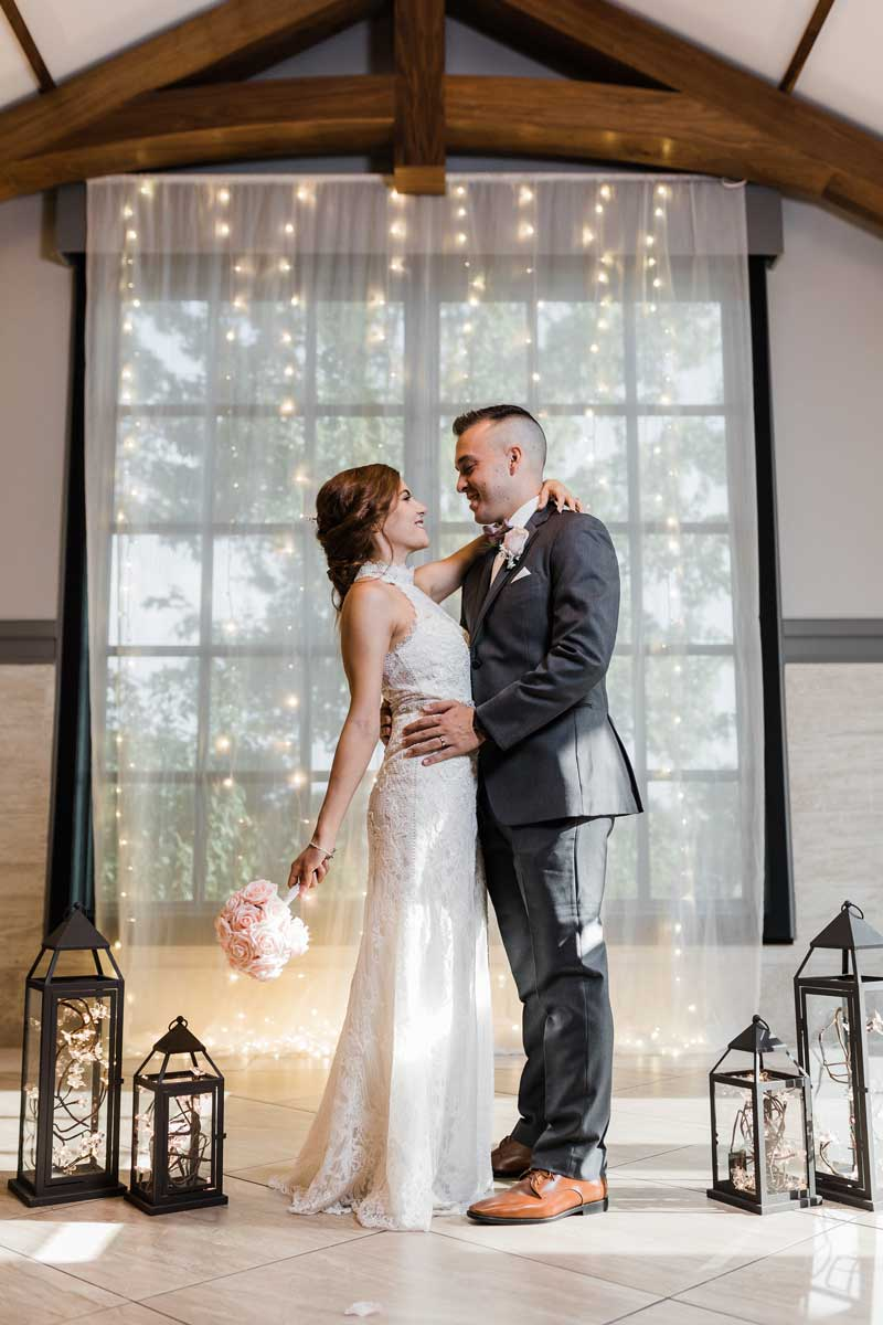 Newlyweds posed in elegant hall at The Ark in Katy