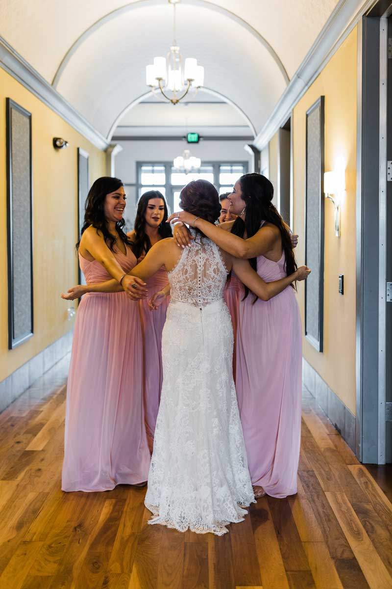 photo of the bride talking with bridesmaids