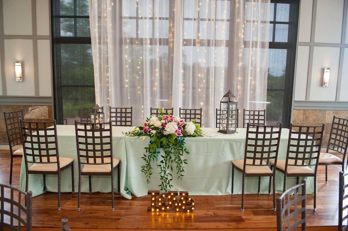 bride and groom table decorated in mint green palette at The Ark in Katy