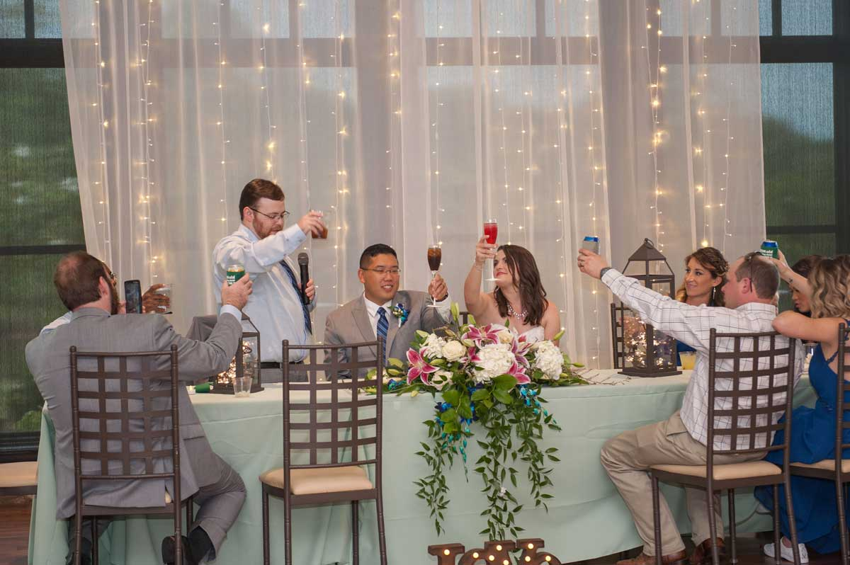 photo of the bride and groom toast at The Ark in Katy