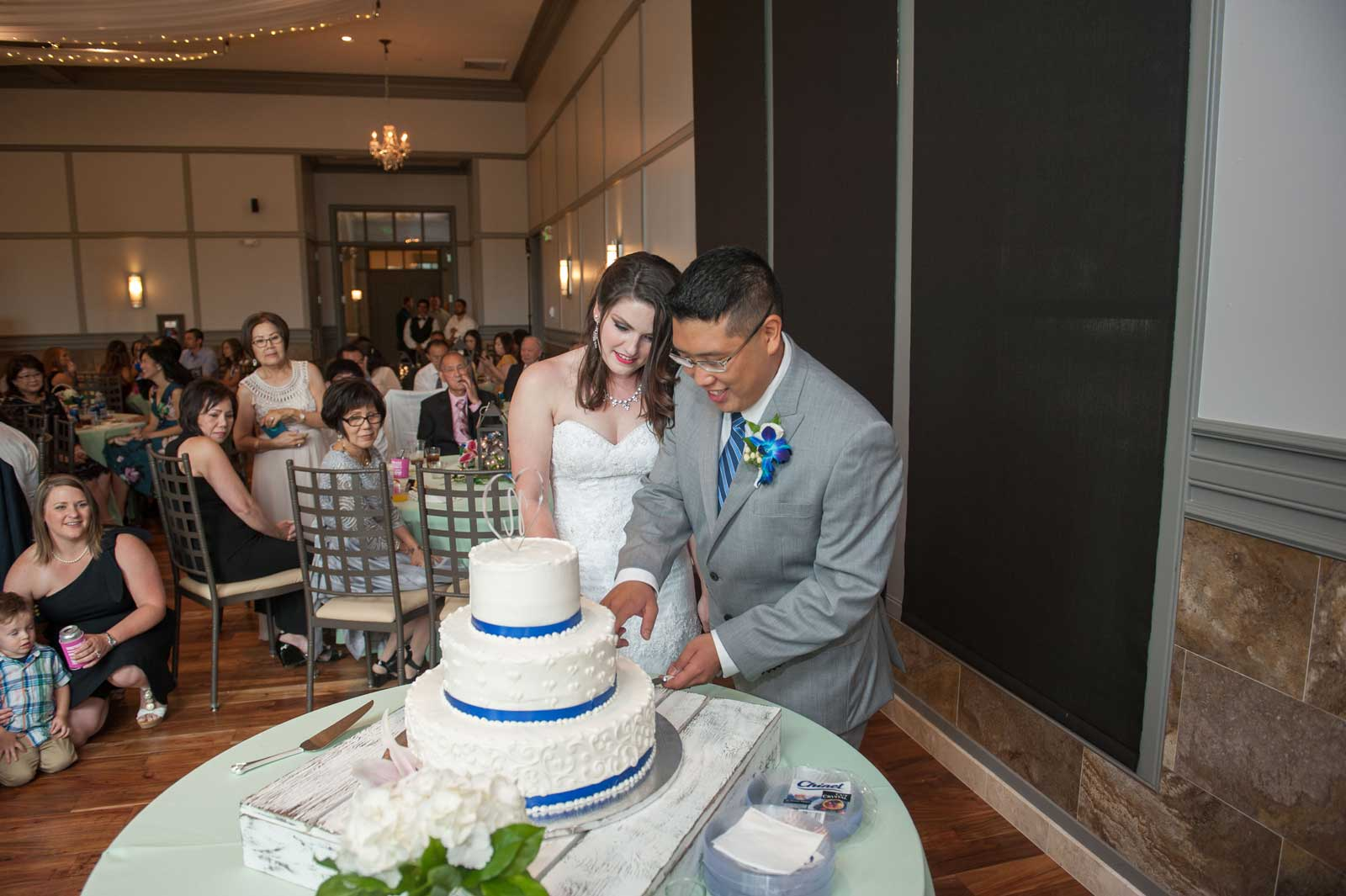 The bride and groom share cake at The Ark in Katy