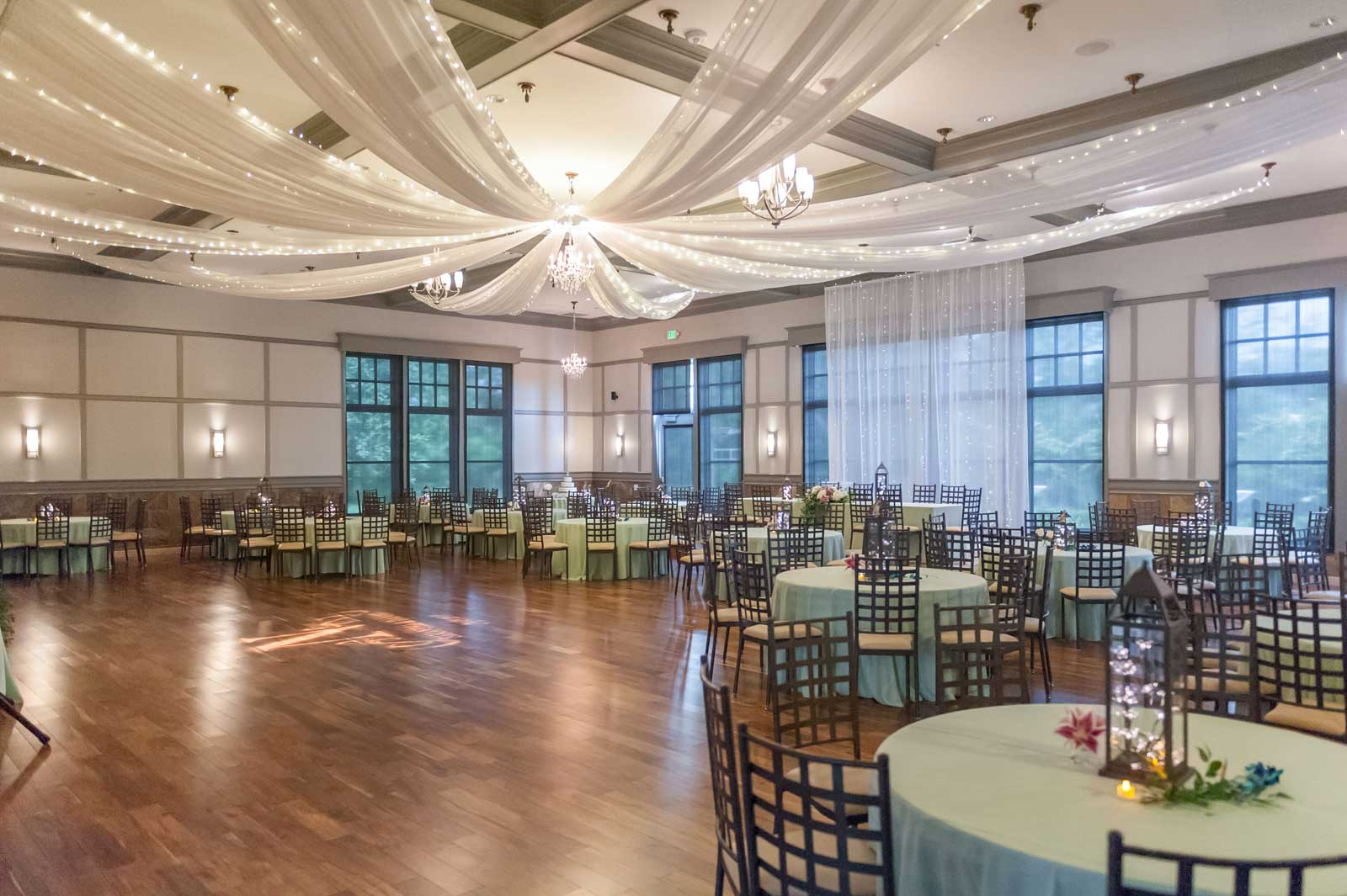 photo of event ballroom set in mint green and white at The Ark in Katy