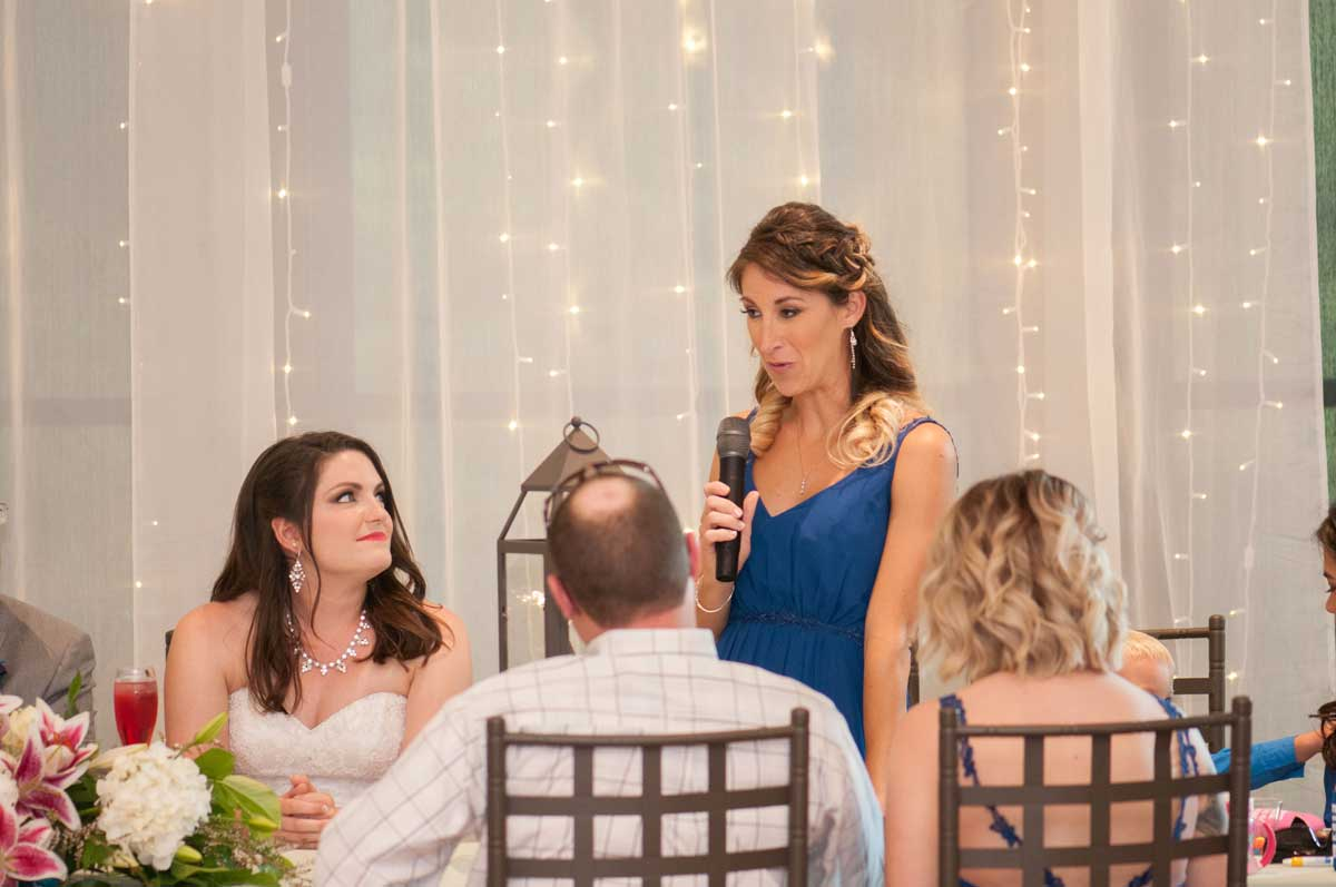 bridesmaid speaking to the happy couple at The Ark in Katy