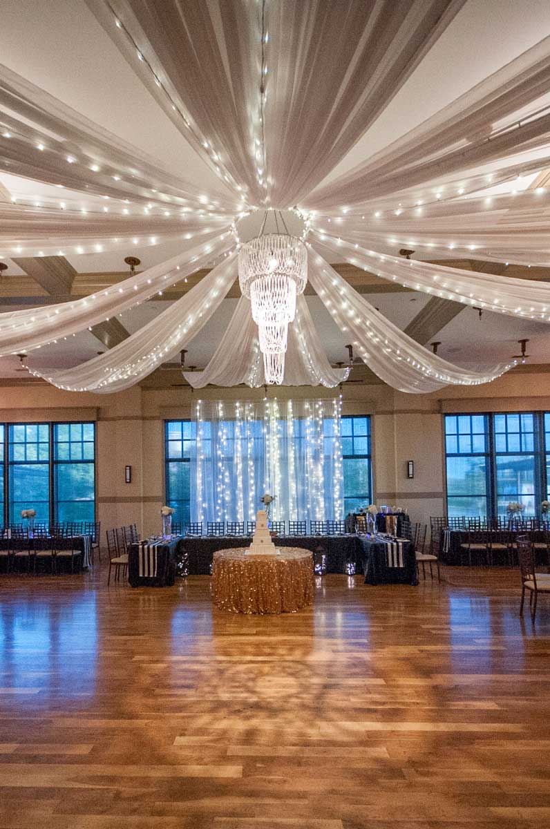 photo of custom sweeping fabric chandelier in the ballroom at The Ark in Katy