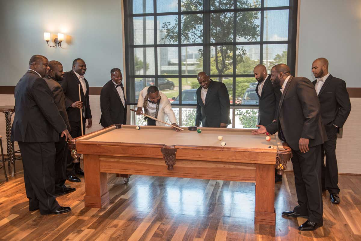 photo of groom and groomsmen playing pool at The Ark in Katy
