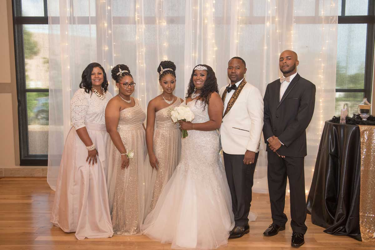 photo of the bride, groom and family at The Ark in Katy