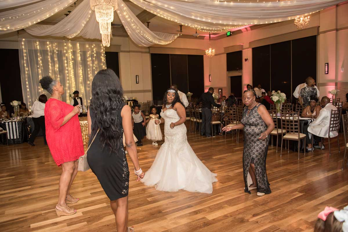 bride and guests dancing at the reception at The Ark in Katy